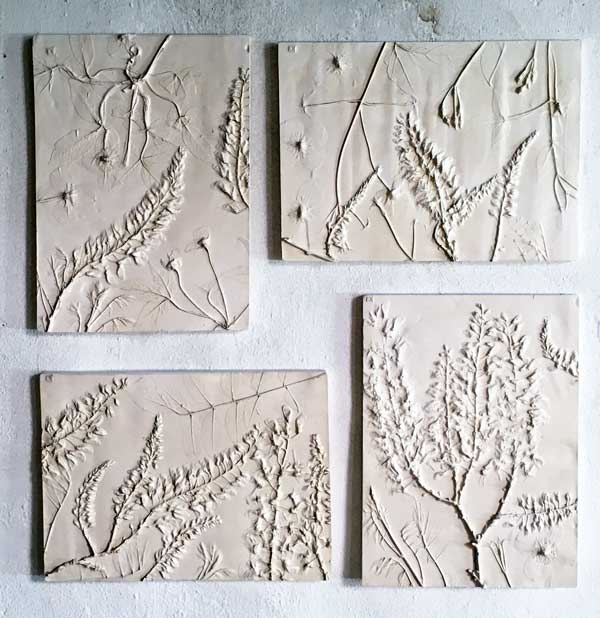 pressed flowers into clay